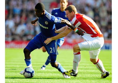 Salomon Kalou of Chelsea is challenged by Robert Huth of Stoke City