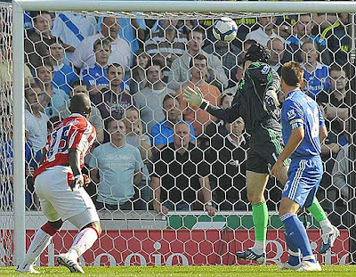 Chelsea's Czech goalkeeper Petr Cech and Chelsea's English captain John Terry (right) watch as Stoke City's Senegalese captain Abdoulaye Faye (left) scores the first goal of their match at the Britannia Stadium, Stoke-on-Trent, Staffordshire.
