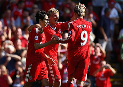 Yossi Benayoun (left), Dirk Kuyt (center) and Fernando Torres (right) of Liverpool celebrate after Benayoun scored his team's first goal against Burnley.