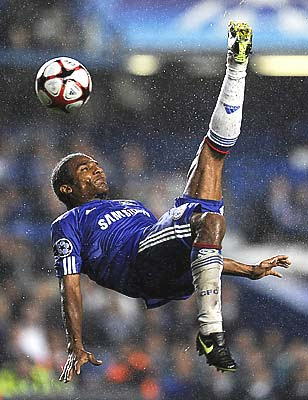 Chelsea's French player Florent Malouda kicks a ball overhead against Porto.
