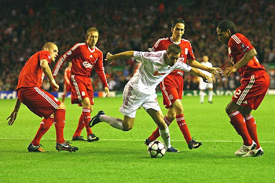 Peter Szakaly of Debrecen is surrounded by the Liverpool defense