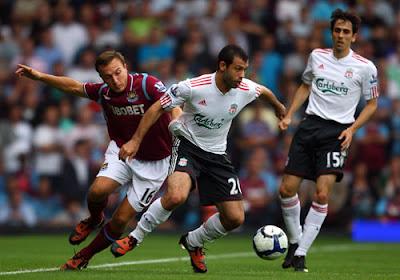 Javier Mascherano of Liverpool battles for the ball with Mark Noble of West Ham United