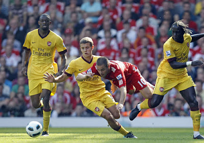 Arsenal's Jack Wilshere battles for the ball with Joe Cole of Liverpool