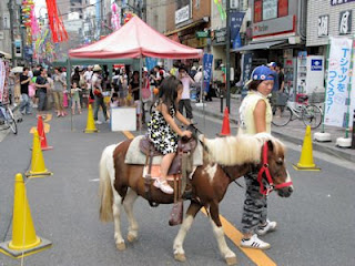 Pony ride at Yoyogi-hachiman street festival, Tokyo.