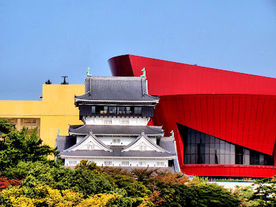Kokura Castle, with a backdrop of the Riverview Center