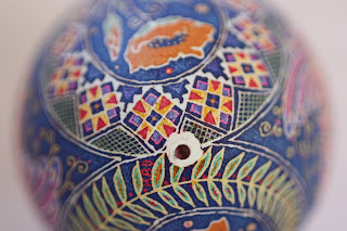 Goose Egg Pysanky with Orange Poppies and Peacocks on Cobalt Blue Background