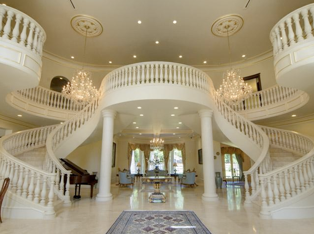 Grand Foyer Definition : Beautiful double curved staircases in texas luxury
