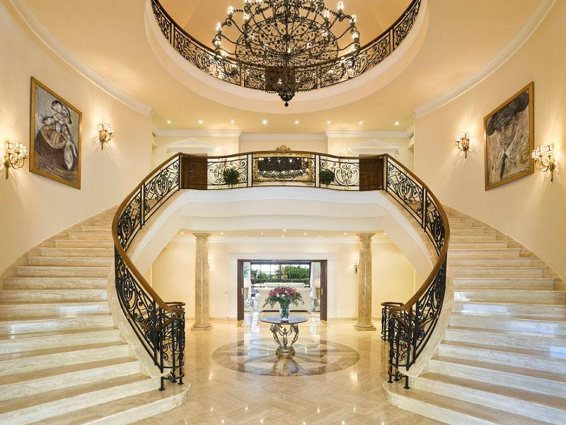 Beautiful double marble curved staircase in a villa in for Double curved staircase