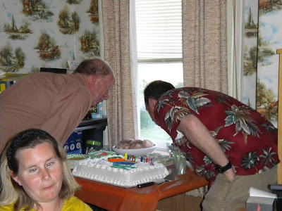 Dad and Uncle Steven blowing out the candles