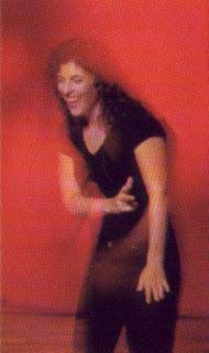 singer-poet Lisa B (Lisa Bernstein) laughs