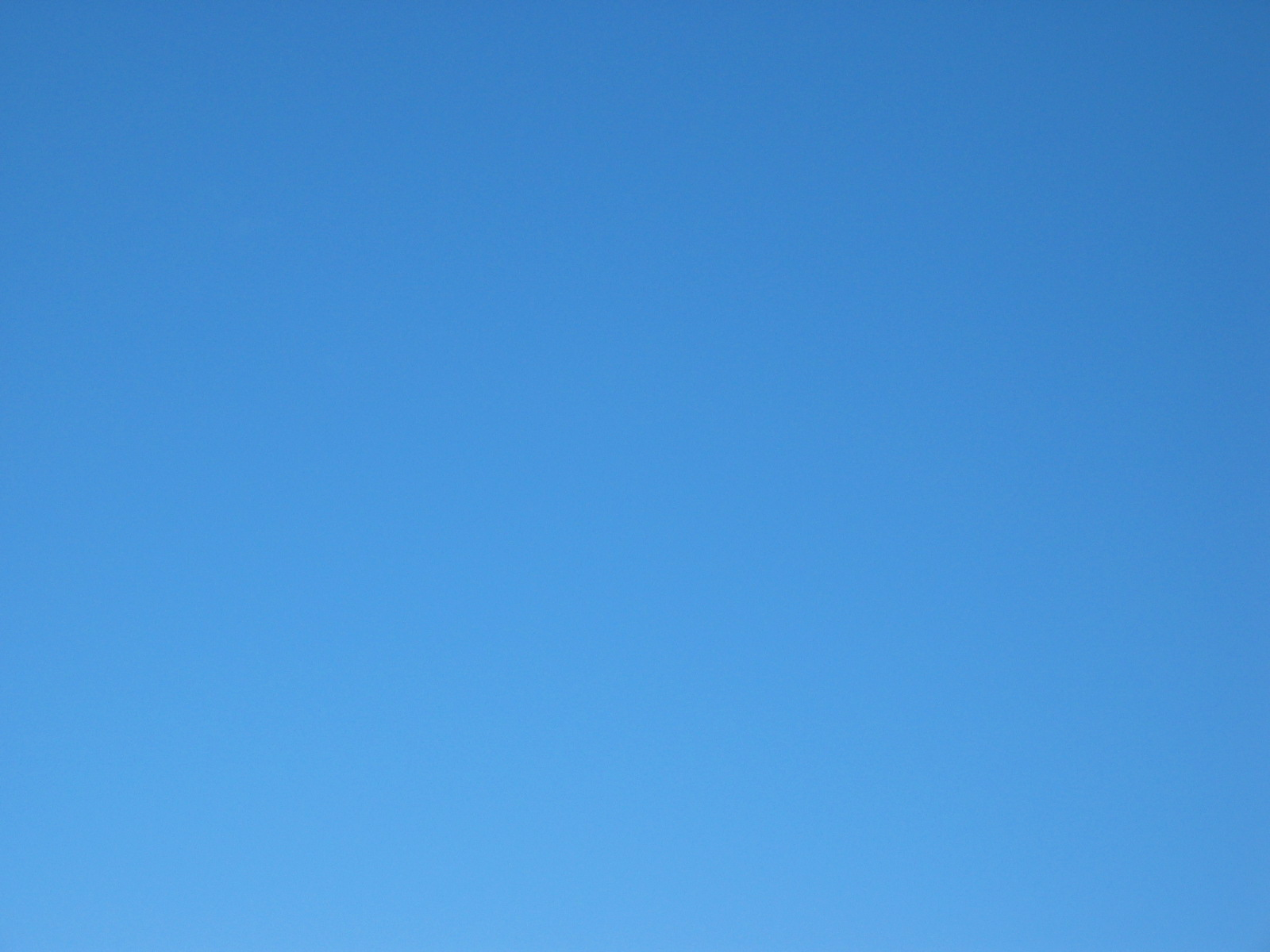 Totally clear blue sky. Not just clear of clouds but clear of vapour trails.