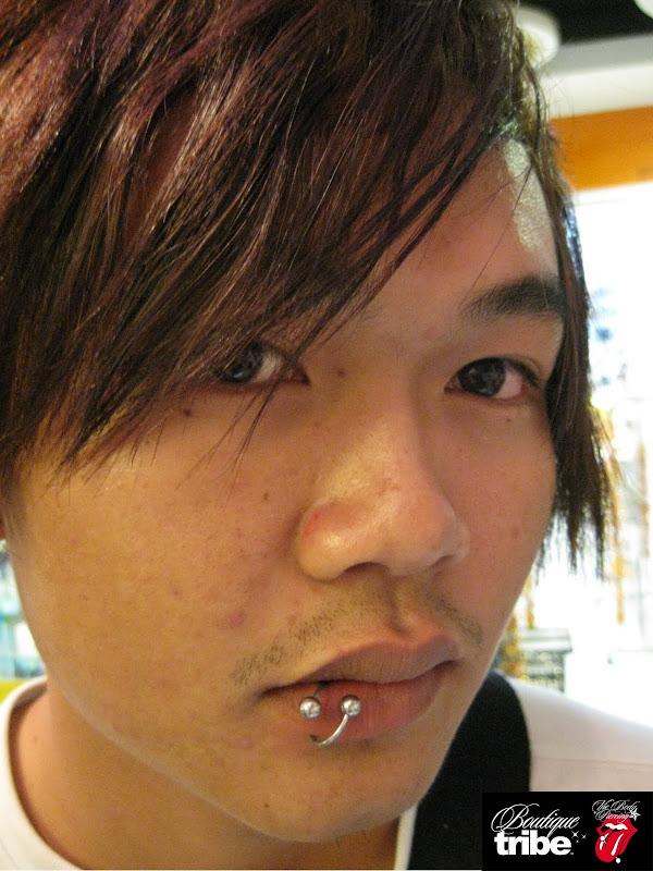 Lips piercing title=