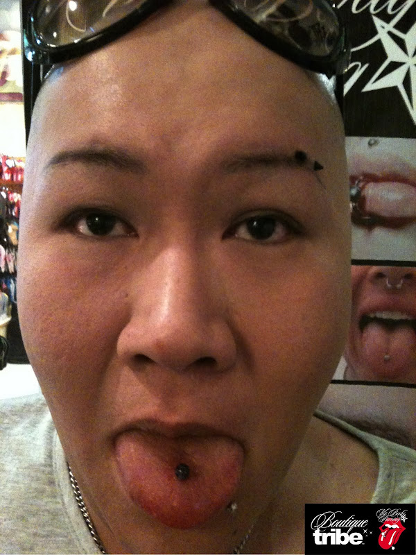 Eyebrow piercing & tongue piercing title=