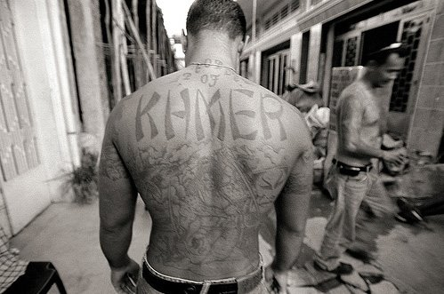 former leader of the Raza Unida prison gang, displays his gang tattoo,