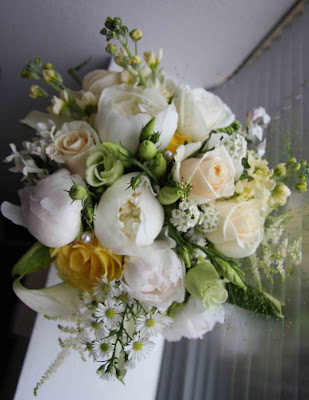 Hand tied vintage style bridal bouquet in sumptuous shades of creams golds