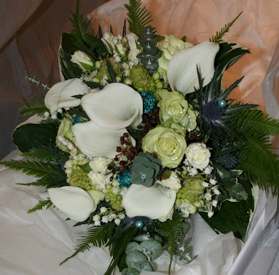 I love this teal wedding bouquet Teal wedding flowers are quite problematic
