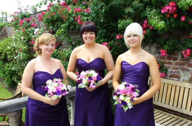 The exquisite Bridesmaids dressed in purple with Pink Purple bouquets