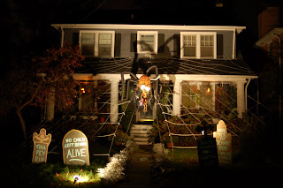 Halloween display featuring a giant spider dressed up as Sarah Palin