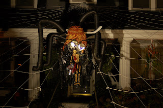 Close-up of a Halloween display featuring a giant spider dressed up as Sarah Palin