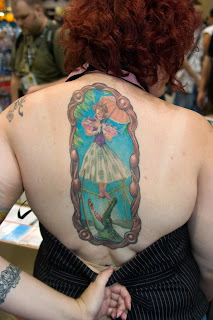 tattoo of one of the stretching room portraits on a woman's back