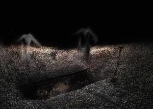 حفرة قبر وشبحان عليها
