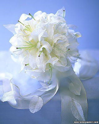 This bouquet is perfect for a winter wedding. Casablanca lilies, some a