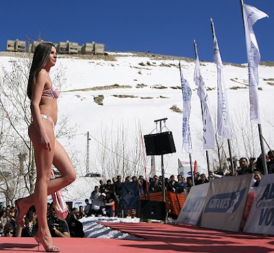 Right: A model presents a bikini collection during a fashion show at a ski ...