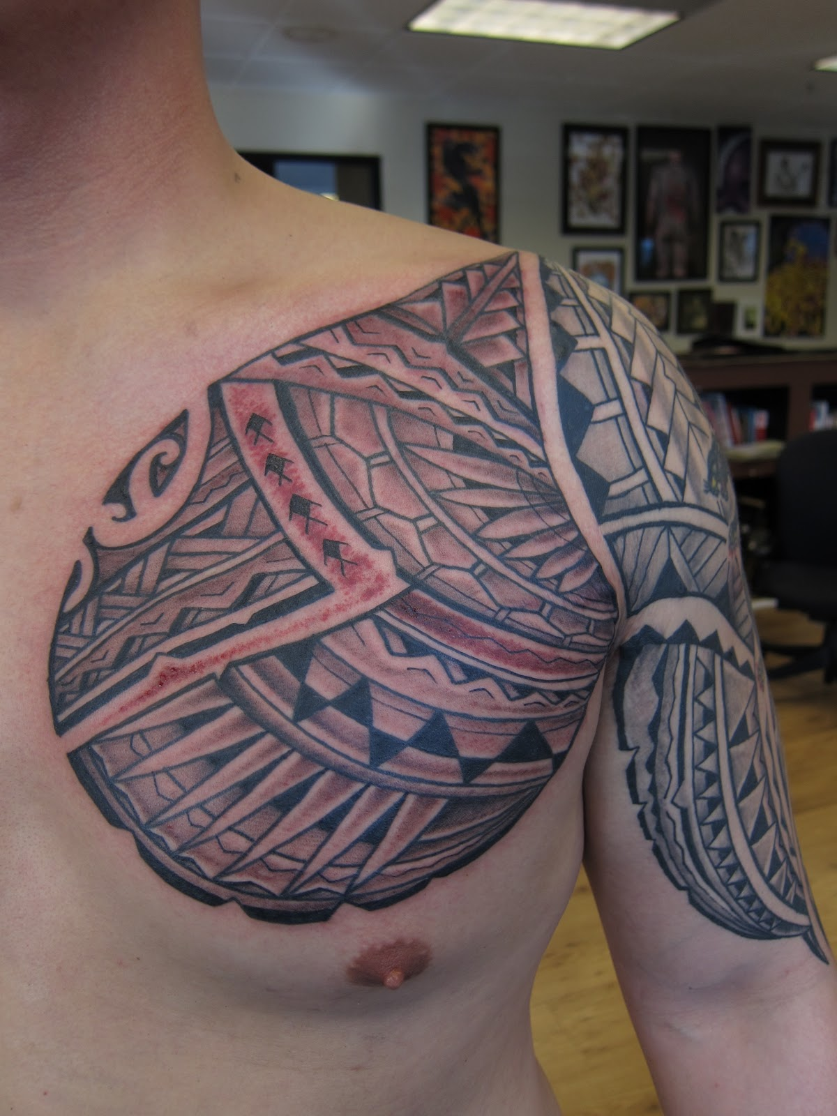 Body tattoos january 2011 for Chest plate tattoos