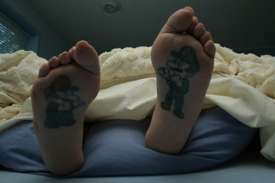 baby feet tattoo. aby feet tattoo