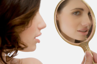 woman+holding+mirror Mirror Mirror: What Are Your Best &amp; Worst Features?