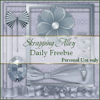 http://skrappingalley.blogspot.com/2009/07/daily-freebie-mini-kit-blue-eraser.html