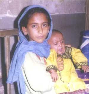 young Pakistani girl with her child