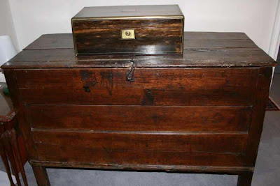 writing box on a wooden chest