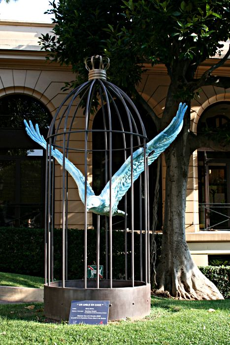 Sculpture of a caged eagle