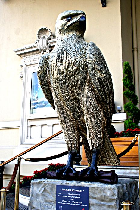 Sculpture of an eagle covered in chain mail