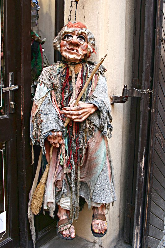 marionette hanging in a doorway in Prague