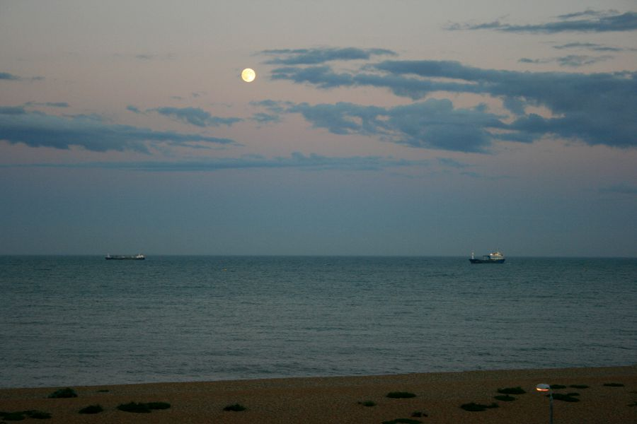 Two ships on the eveing sea, moon above