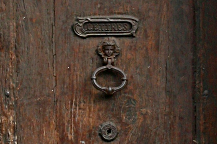 letter box in a dark wood door