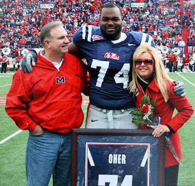 The real Oher with the Tuohys