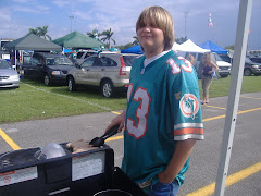 Jimmy grilling brats before Dolphins game