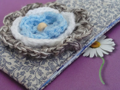 Quilted eyeglass case with crocheted flower on Etsy
