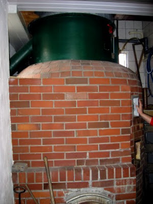 The wood-fired kettle, with the lauter tun above