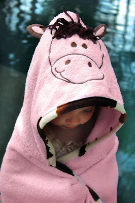 Manual Woodworkers and Weavers Izzy collection of children's decor, apparel and gifts includes this Lil Cow Pokie Hooded Towel