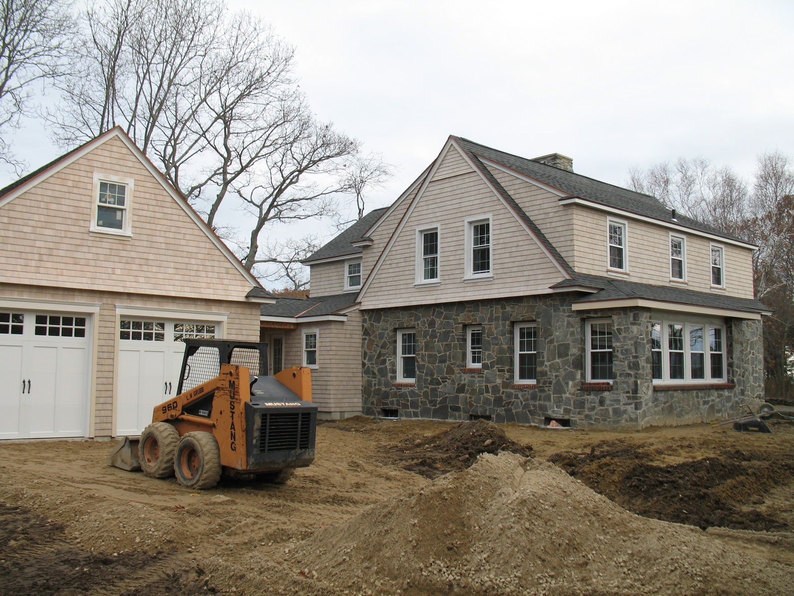 Woodstone construction ocean view stone manor for Garage additions pictures