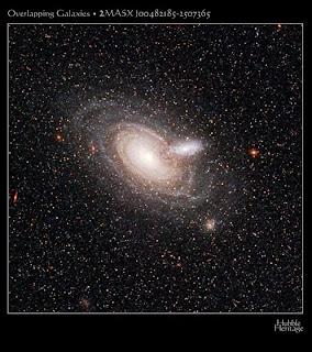 Galaxias 2MASX J00482185-2507365
