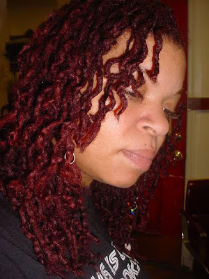 the intense color of her fiery red mane of healthy, and luscious locs