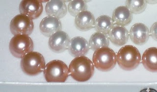 Paula's two strands of pearls. One strand of 9-10 mm white, and a strand of 10-11 mm pastel.
