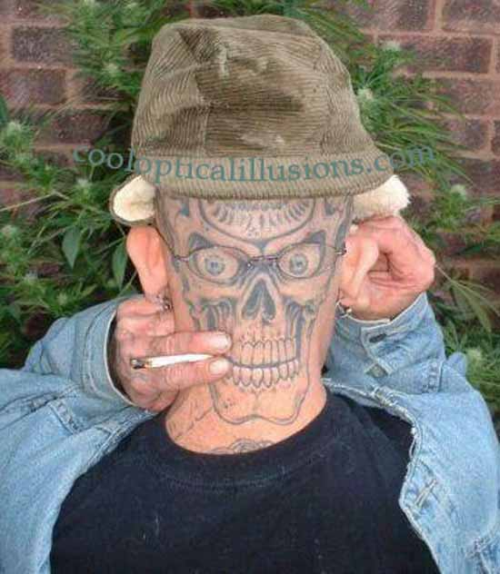 Tattoo, like a face in back of face, smoking