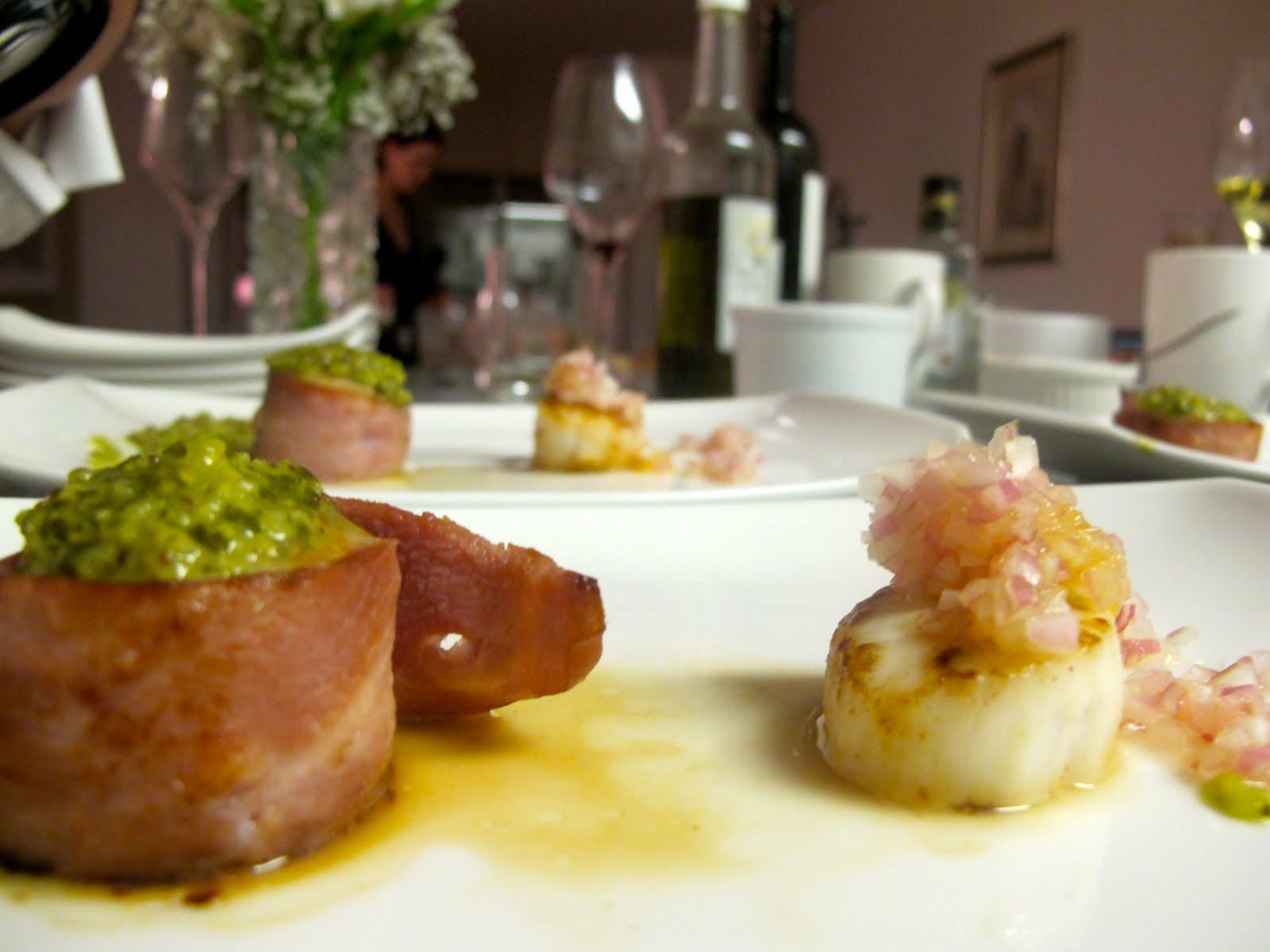 the left, a turkey bacon wrapped seared scallop with a cilantro pesto ...