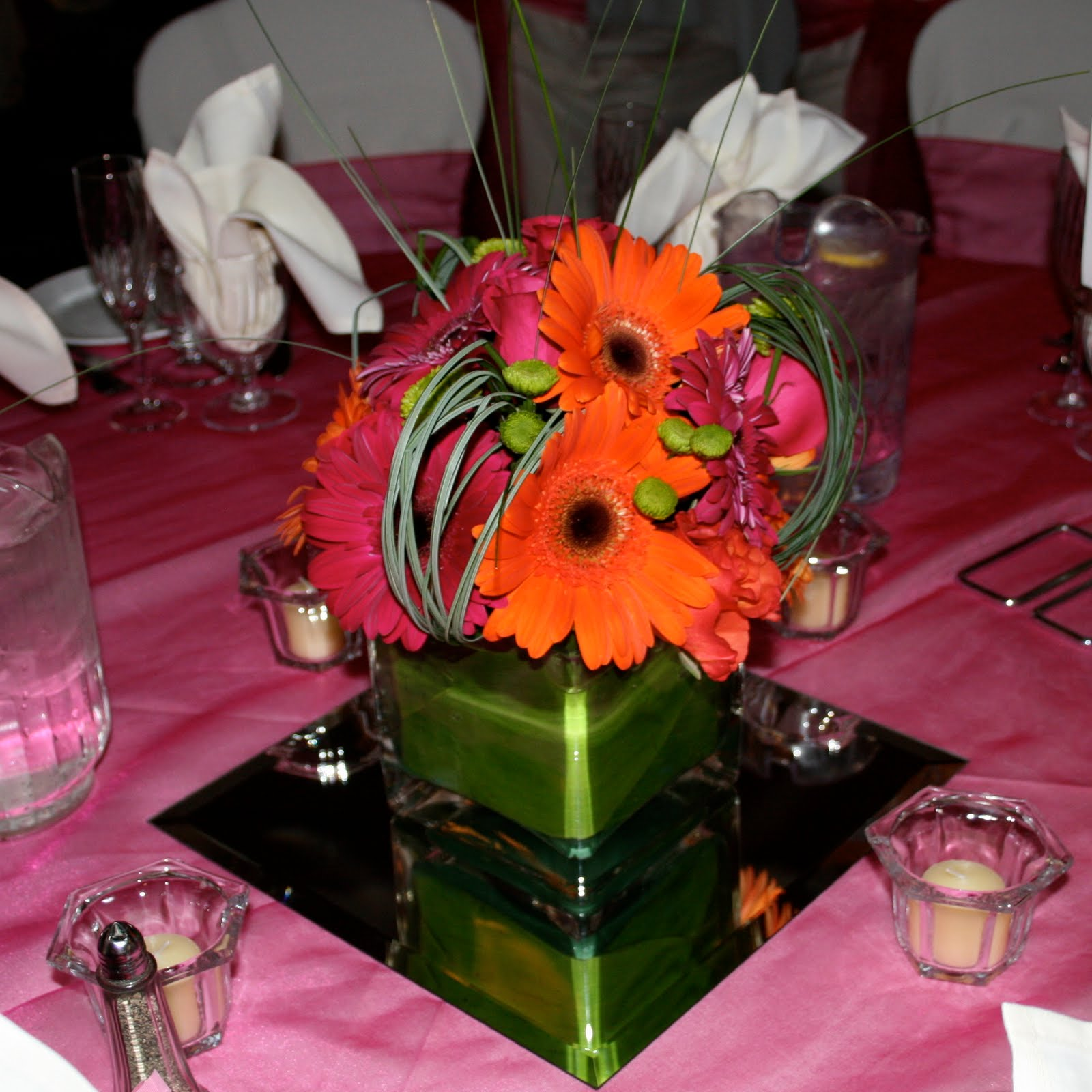 Brown bunny flowers may 22 2010 laurie and kevins wedding the second centerpieces were square rings of flowers surrounding a square glass vase with floating candles the rings of flowers were hand placed fuchsia reviewsmspy
